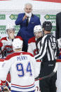 Montreal Canadiens coach Dominique Ducharme talks to a linesman during the third period of Game 2 of an NHL hockey Stanley Cup second-round playoff series against the Winnipeg Jets on Friday, June 4, 2021, in Winnipeg, Manitoba. (John Woods/The Canadian Press via AP)