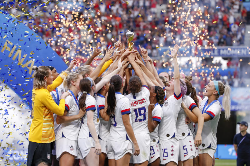 LYON, FRANCE - JULY 07: Megan Rapinoe #15 of USA and Team USA celebrate the victory of the 2019 FIFA Women's World Cup France Final match between The United States of America and The Netherlands at Stade de Lyon on July 7, 2019 in Lyon, France. (Photo by Catherine Steenkeste/Getty Images)