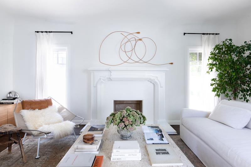 """Georgia loves a midcentury modern piece, but was just as concerned with making sure the space made her feel at home. """"I mixed comfortable couches with midcentury lighting or chairs,"""" she says. """"Balancing old and new and only bringing in pieces I loved made the space me."""""""