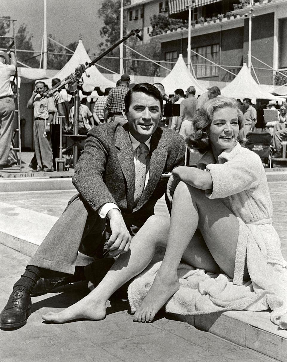 """In this image released by Beverly Hills Collection, actors Gregory Peck, left, and Lauren Bacall are seen while shooting the film """"Designing Woman"""" at The Beverly Hills Hotel. The Beverly Hills Hotel is celebrating its 100th Anniversary in May. (AP Photo/Beverly Hills Collection)"""