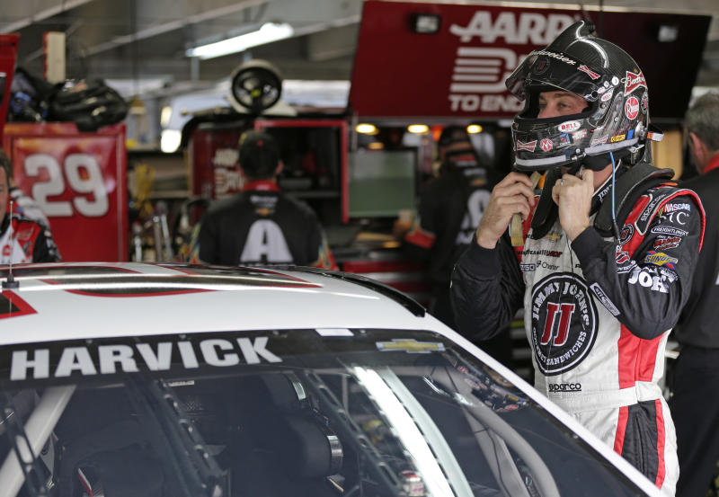 Kevin Harvick prepares for practice for Saturday's NASCAR Sprint Cup auto race at Charlotte Motor Speedway in Concord, N.C., Thursday, Oct. 10, 2013. (AP Photo/Chuck Burton)