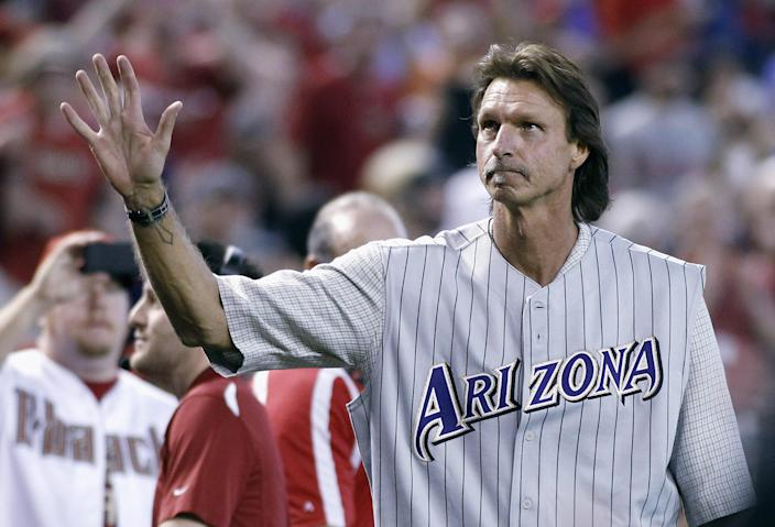 PHOENIX, AZ - MAY 18: Former Arizona Diamondbacks pitcher Randy Johnson waves to fans during a ceremony celebrating the 10th anniversary of his perfect game before the start of a MLB game between the Diamondbacks and Los Angeles Dodgers at Chase Field on May 18, 2014 in Phoenix, Arizona. Ralph Freso/Getty Images/AFP (AFP Photo/Ralph Freso)