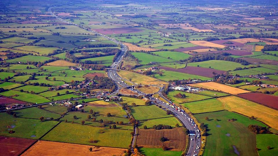 Aerial view of the M56 motorway in the Cheshire countryside