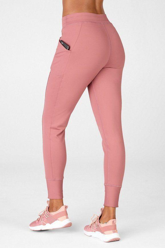 """<p><strong>fabletics</strong></p><p>fabletics.com</p><p><strong>$74.95</strong></p><p><a href=""""https://go.redirectingat.com?id=74968X1596630&url=https%3A%2F%2Fwww.fabletics.com%2Fproducts%2FON-THE-GO-COLD-WEATHER-JOGGER-PT2044870-7283&sref=https%3A%2F%2Fwww.womenshealthmag.com%2Ffitness%2Fg36719192%2Fbest-joggers-for-women%2F"""" rel=""""nofollow noopener"""" target=""""_blank"""" data-ylk=""""slk:Shop Now"""" class=""""link rapid-noclick-resp"""">Shop Now</a></p><p>Annie Copinga, instructor XPRO for <a href=""""http://www.yogasix.com/go"""" rel=""""nofollow noopener"""" target=""""_blank"""" data-ylk=""""slk:YogaSix GO"""" class=""""link rapid-noclick-resp"""">YogaSix GO</a>, raves about these silky-smooth joggers for yoga, even during a heated flow. """"They're a must for yoga due to their sculpting compression yet breathable fabric for those hot yoga sessions,"""" she says. """"The side pockets are also a major benefit for running those errands post-class. I'm a big fan of fun colors that pop in the studios. The cherry mocha shade is my summer favorite.""""</p>"""