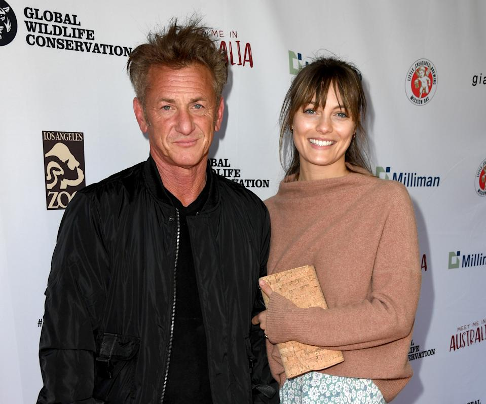 """Sean Penn (L) and Leila George arrive at the """"Meet Me In Australia"""" event benefiting Australia Wildfire Relief Efforts at Los Angeles Zoo on March 08, 2020 in Los Angeles, California."""