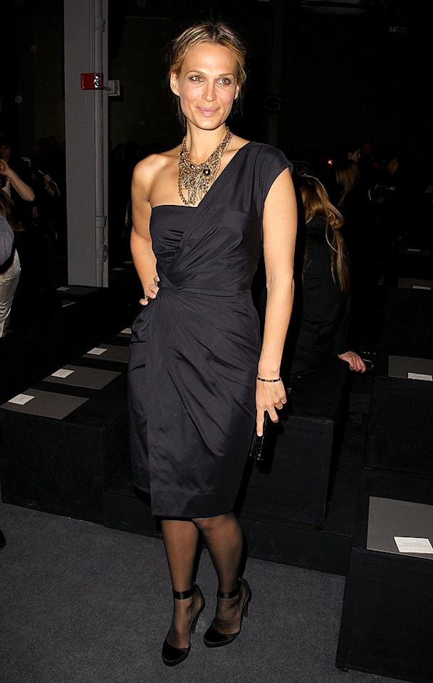 """Molly Sims hit the mark in a dark Donna Karan one-shoulder dress and statement necklace at NYC's Fashion Week. Andrew H. Walker/<a href=""""http://www.gettyimages.com/"""" target=""""new"""">GettyImages.com</a> - February 16, 2009"""