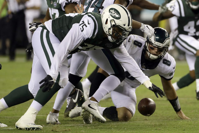 New York Jets' Xavier Cooper (75) recovers a fumble by Philadelphia Eagles' Christian Hackenberg (8) during the second half of a preseason NFL football game Thursday, Aug. 30, 2018, in Philadelphia. (AP Photo/Michael Perez)