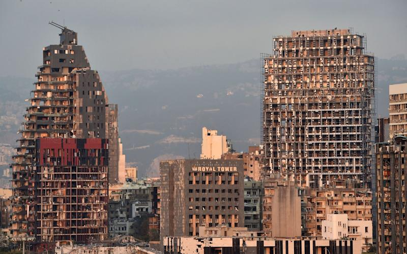 Some buildings in Beirut still standing bear the scars of the explosions - EPA