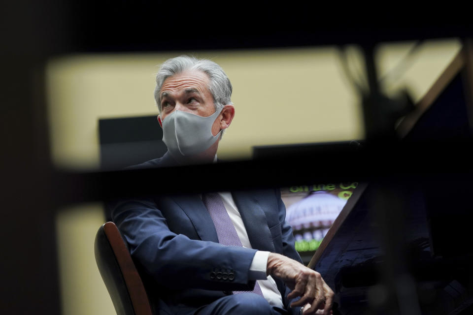 Federal Reserve Chair Jerome Powell wears a protective mask as he arrives for a House Select Subcommittee on the Coronavirus hearing on Capitol Hill in Washington on Wednesday, Sept. 23, 2020. (Stefani Reynolds/Pool via AP)