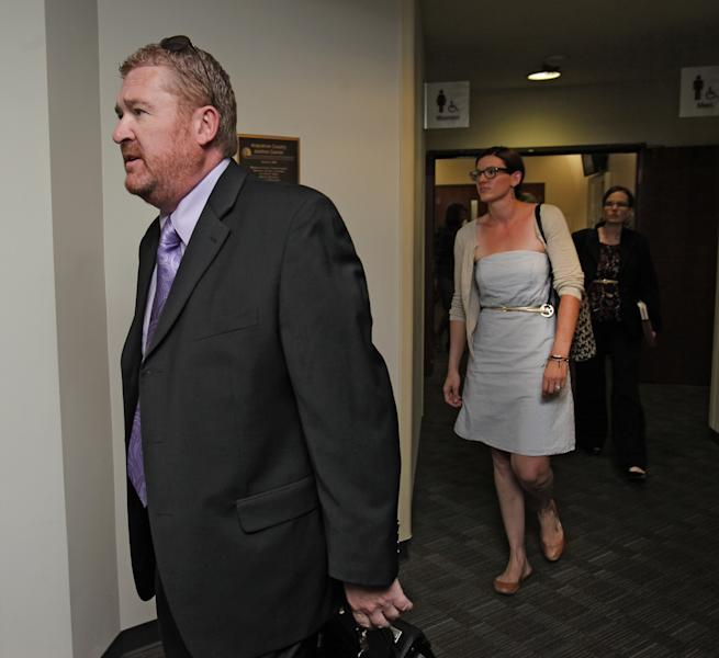 Defense attorney Daniel King leads other public defenders into court for a motions hearing for suspected movie theater shooter James Holmes in district court in Centennial, Colo., on Thursday, Aug. 30, 2012. Holmes has been charged in the shooting at the Aurora theater on July 20 that killed twelve people and injured more than 50. (AP Photo/Barry Gutierrez)
