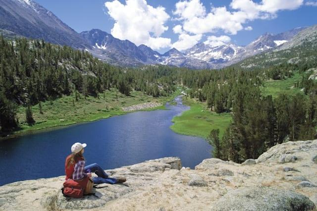 Woman sitting in the Mammoth Lakes in the summer