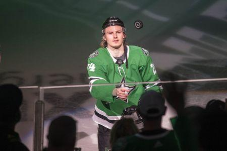 Apr 17, 2019; Dallas, TX, USA; Dallas Stars left wing Roope Hintz (24) throws a puck to the fans after being named the number one star after defeating the Nashville Predators in game four of the first round of the 2019 Stanley Cup Playoffs at American Airlines Center. Mandatory Credit: Jerome Miron-USA TODAY Sports