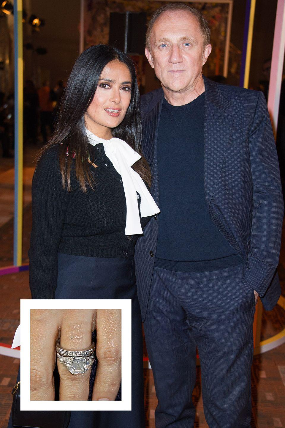 """<p>Salma Hayek and French businessman François-Henri Pinault married in 2009. Hayek's gorgeous engagement ring is a five-carat oval-cut center stone with two trillion diamond accents on the side, <a href=""""https://www.brides.com/photos/celebrity-engagement-ring-photos-salma-hayek"""" rel=""""nofollow noopener"""" target=""""_blank"""" data-ylk=""""slk:Brides reports."""" class=""""link rapid-noclick-resp""""><em>Brides </em>reports.</a></p>"""