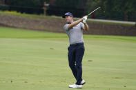 Webb Simpson hits from the fairway on the eighth hole during the first round of the Wyndham Championship golf tournament at Sedgefield Country Club on Thursday, Aug. 13, 2020, in Greensboro, N.C. (AP Photo/Chris Carlson)