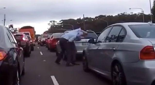 The men could be seen grappling with one another. Source: Facebook/ DashCam Owners Australia