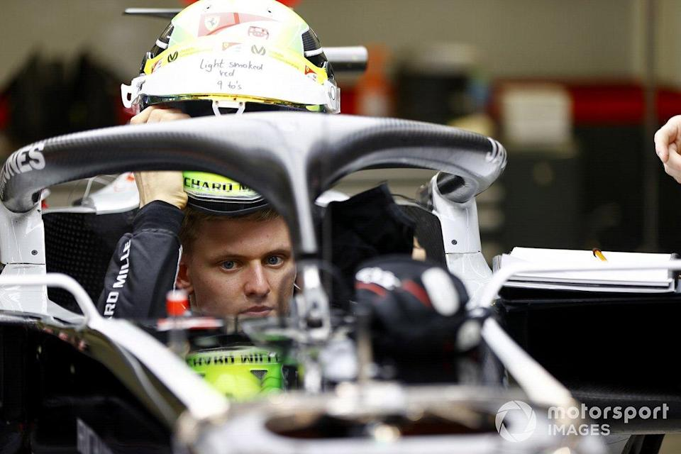 """Mick Schumacher sits in his Haas VF-20 for his seat fitting<span class=""""copyright"""">Andy Hone / Motorsport Images</span>"""