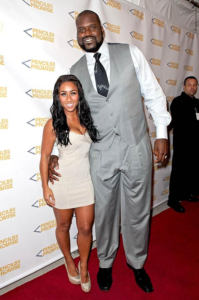 "Former NBA hoopster Shaquille O'Neal and girlfriend Nicole ""Hoopz"" Alexander made for an odd-looking couple, thanks to their height difference! The petite former ""Flavor of Love"" star was sexy in a strapless mini dress, while Shaq was handsome in a giant gray suit. (11/17/2011)"