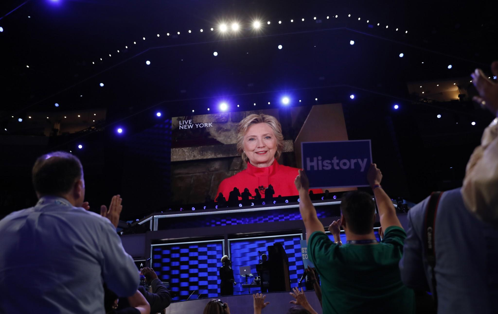 Hillary Clinton appears on a video monitor streamed live from New York at the Democratic National Convention on Tuesday. (Photo: Mark Kauzlarich/Reuters)