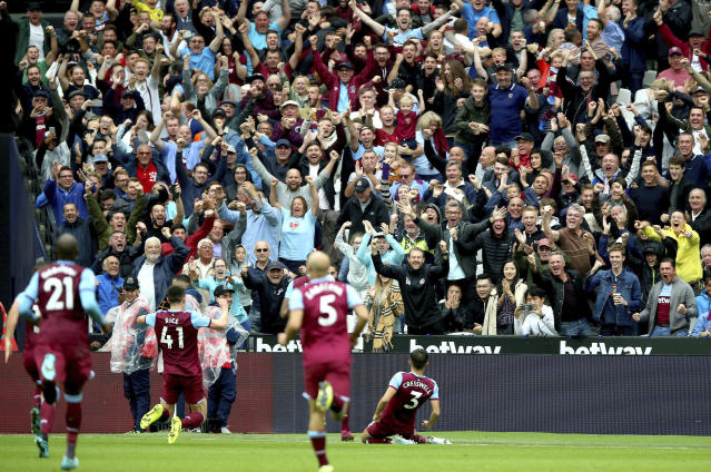 West Ham United's Aaron Cresswell, right, celebrates scoring against Manchester United during the English Premier League soccer match at London Stadium, Sunday Sept. 22, 2019. (Nigel French/PA via AP)