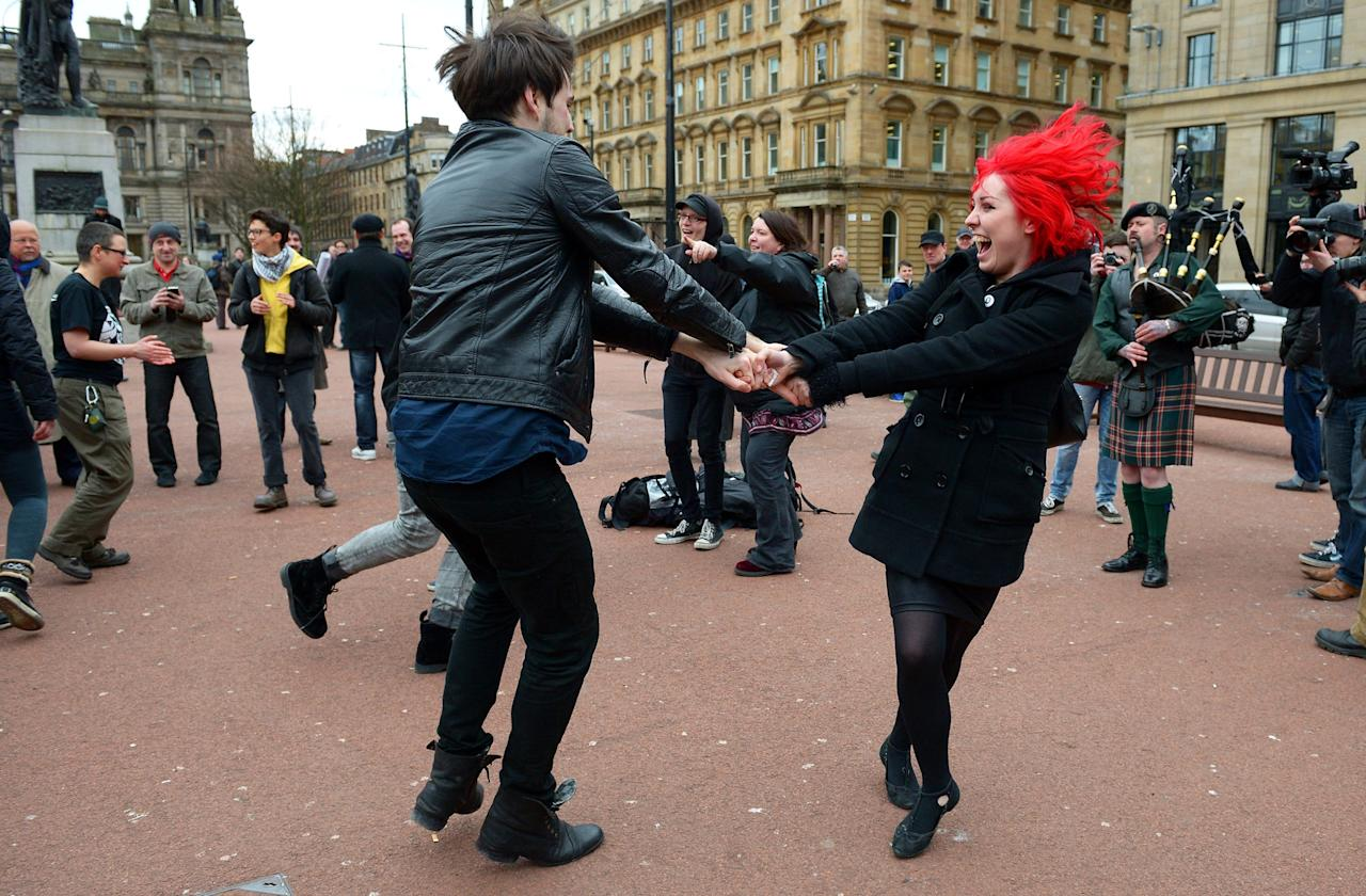 GLASGOW, UNITED KINGDOM - APRIL 08:  Members of the public dance in George Square to mark the death of Baroness Margaret Thatcher on April 8, 2013 in Glasgow, Scotland. It has been confirmed that Lady Thatcher has died this morning following a stroke aged 87. Margaret Thatcher was the first female British Prime Minster and governed the UK from 1979  to 1990. She led the UK through some turbulent years and contentious issues including the Falklands War, the miners' strike and the Poll Tax riots.  (Photo by Jeff J Mitchell/Getty Images)
