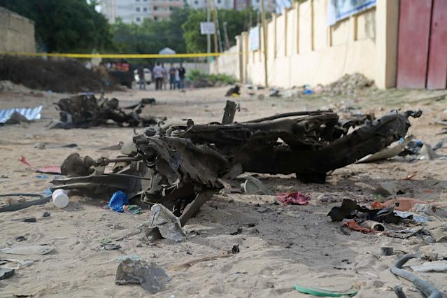 <p>A destroyed car is seen at the site after bomb-laden vehicle attack by Al-Shabaab militants to a restaurant in Mogadishu, Somalia on June 15, 2017. (Photo: Saadaq Maxamed/Anadolu Agency/Getty Images) </p>