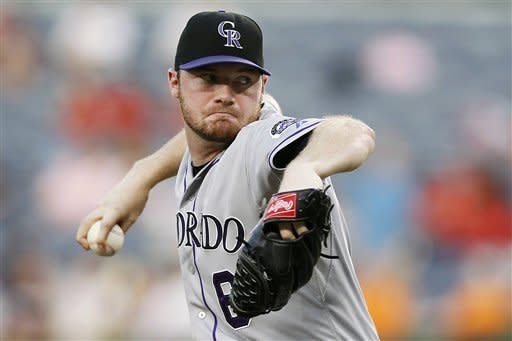 Colorado Rockies starting pitcher Alex White (6) works in the first inning of a baseball game against the Atlanta Braves, Wednesday, Sept. 5, 2012, in Atlanta. (AP Photo/John Bazemore)
