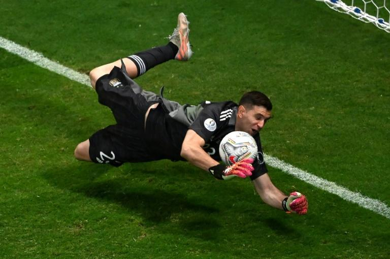 Argentina goalkeeper Emiliano Martinez makes one of three penalty shoot-out saves to send his country into a dream Copa America final against Brazil