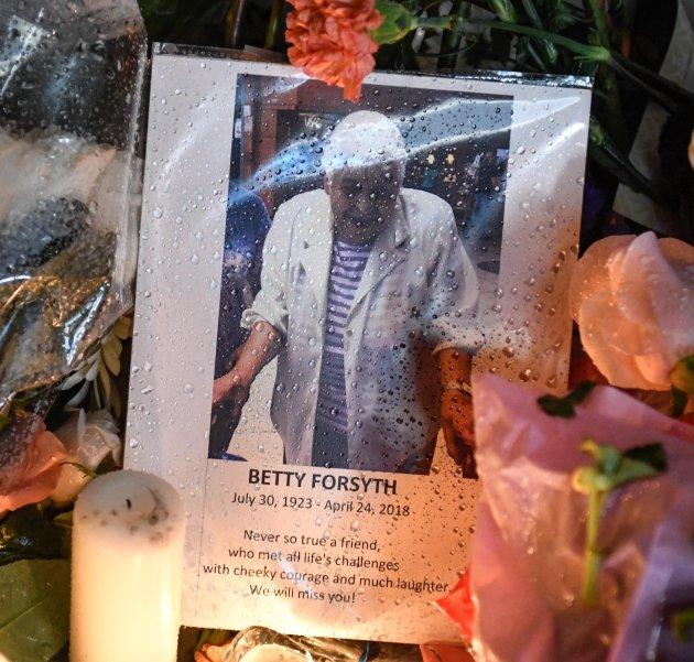 A photo of Betty Forsyth is shown at a vigil on Yonge Street in Toronto on Tuesday.