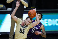 Northwestern guard Boo Buie (0) becomes entangled with Purdue guard Sasha Stefanovic (55) during the first half of an NCAA college basketball game in West Lafayette, Ind., Saturday, Feb. 6, 2021. (AP Photo/Michael Conroy)
