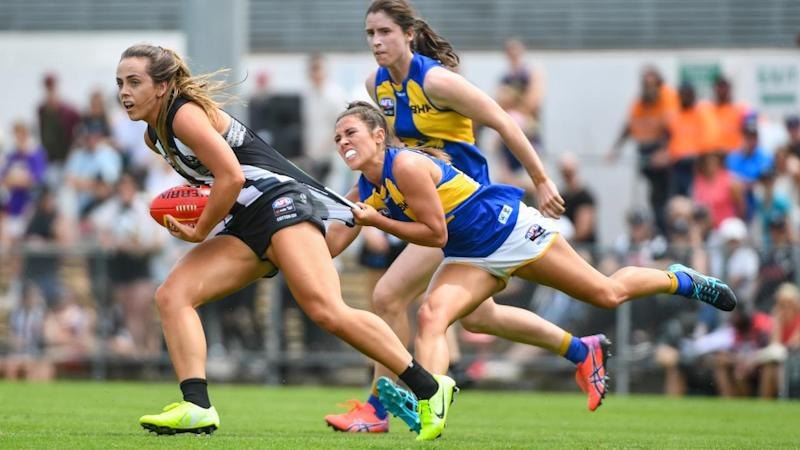 Collingwood's Aishling Sheridan is pulled down in her team's AFLW win over West Coast