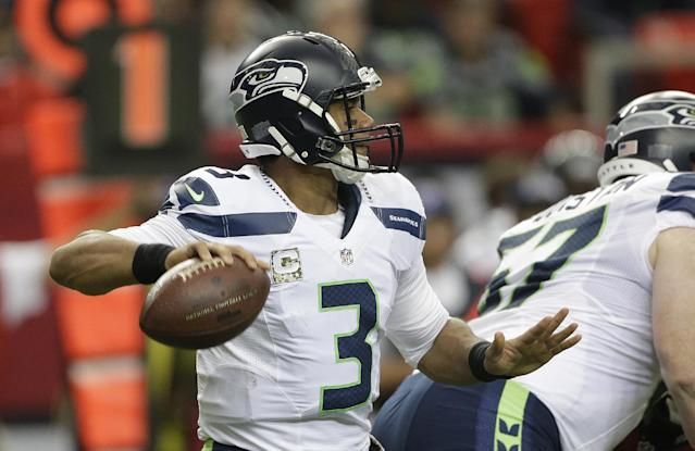 Seattle Seahawks quarterback Russell Wilson (3) works against the Atlanta Falcons during the first half of an NFL football game, Sunday, Nov. 10, 2013, in Atlanta. (AP Photo/John Bazemore)