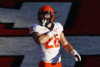 Illinois running back Mike Epstein reacts after scoring a touchdown during the second half of an NCAA college football game against the Rutgers, Saturday, Nov. 14, 2020, in Piscataway, N.J. Illinois won 23 - 20. (AP Photo/Adam Hunger)