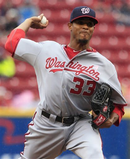 Washington Nationals starting pitcher Edwin Jackson throws against the Cincinnati Reds in the first inning of a baseball game on Sunday, May 13, 2012, in Cincinnati. (AP Photo/Al Behrman)
