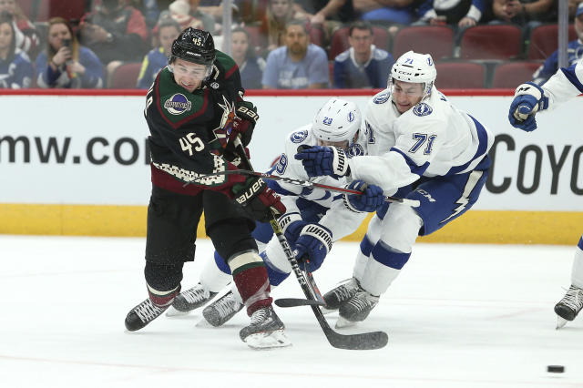 Tampa Bay Lightning's Slater Koekkoek (29) and Anthony Cirelli (71) try to defend against a shot on goal by Arizona Coyotes' Josh Archibald (45) during the second period of an NHL hockey game, Saturday, Oct. 27, 2018, in Glendale, Ariz. (AP Photo/Ralph Freso)