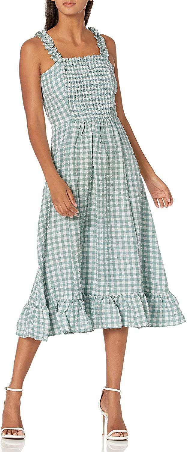 <p>Make a stylish statement in this <span>Sugar Lips Ruffle Smocked Midi Dress</span> ($36), which looks incredibly comfy.</p>