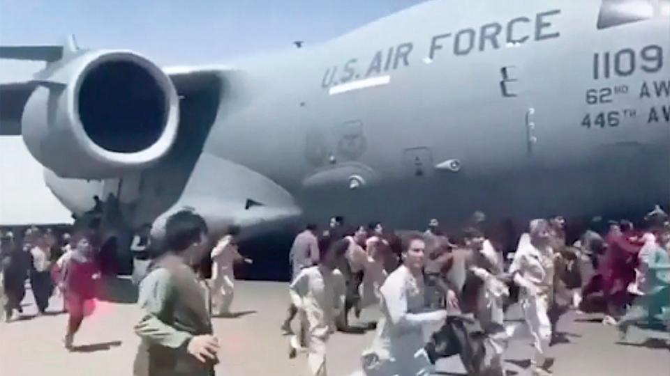 Seen here, Afghanistan civilians run alongside the US aircraft as it evacuates people from the country.