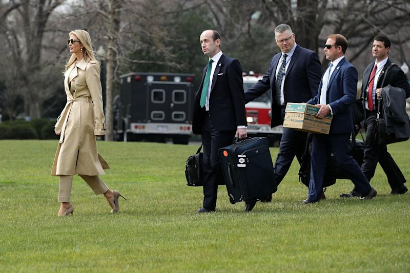 Ivanka Trump, White House senior adviser Stephen Miller, deputy national security adviser Ricky Waddell and deputy director of presidential advance Jordan Karem walk across the South Lawn before departing the White House with U.S. President Donald Trump on March 29.