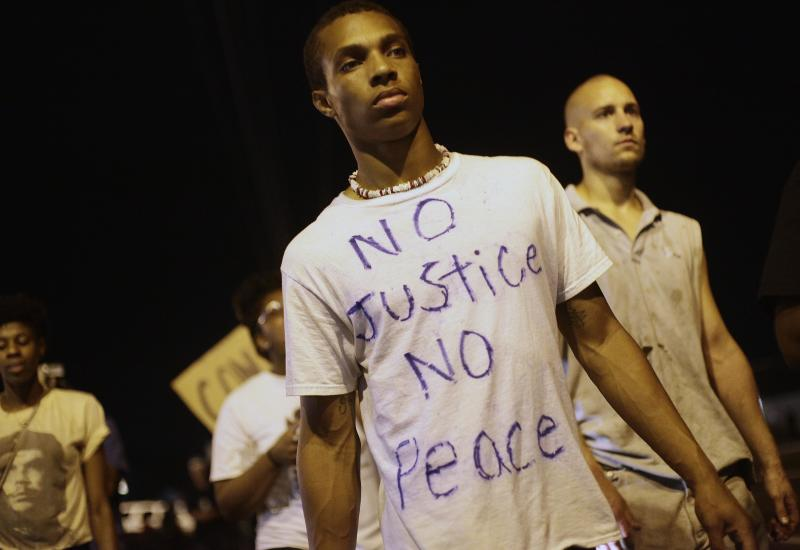 Demonstrators protest the fatal shooting of Michael Brown August 20, 2014 in Ferguson, Missouri