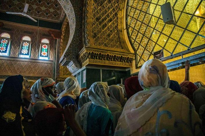 Pilgrims enter the mausoleum in the Great Mosque of Touba during the Grand Magal of Mourides in Touba on September 26, 2021, the largest annual muslim pilgrimage in Senegal, with hundreds of thousands making the pilgrimage each year.