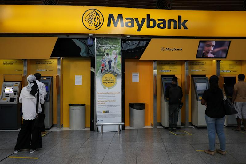 People following social distancing measures wait in line to use ATM machines at a Maybank branch in Kuala Lumpur, amid the coronavirus disease (COVID-19) outbreak in Kuala Lumpur, Malaysia September 9, 2020. REUTERS/Lim Huey Teng