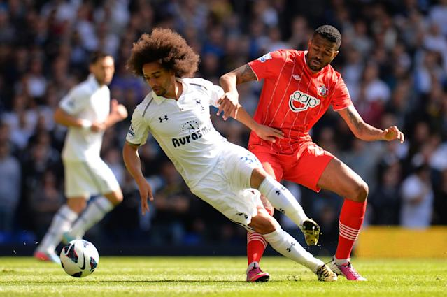 LONDON, ENGLAND - MAY 04: Benoit Assou-Ekotto of Tottenham Hotspur is marshalled by Guilherme do Prado of Southampton during the Barclays Premier League match between Tottenham Hotspur and Southampton at White Hart Lane on May 4, 2013 in London, England. (Photo by Shaun Botterill/Getty Images)