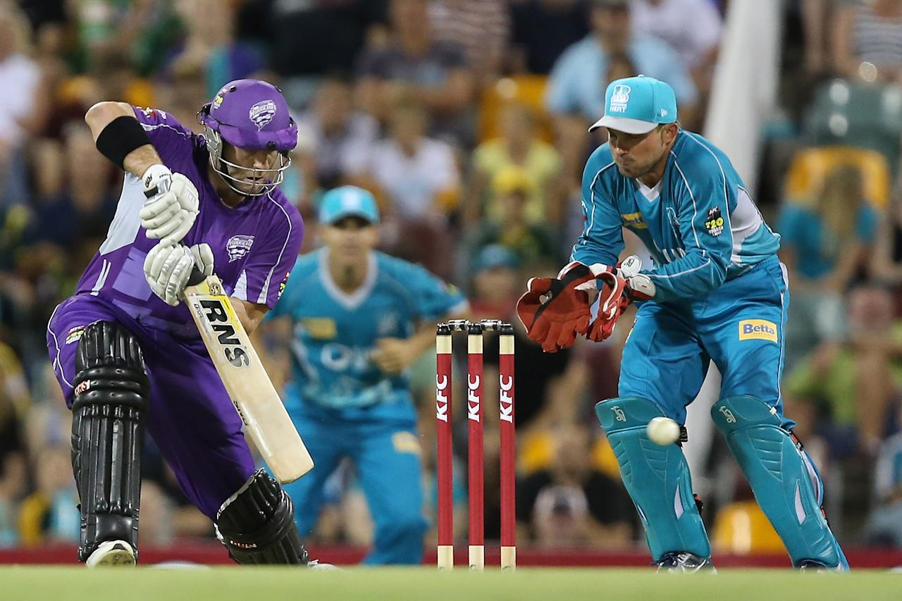 BRISBANE, AUSTRALIA - DECEMBER 09:  Travis Birt of the Hurricanes bats during the Big Bash League match between the Brisbane Heat and the Hobart Hurricanes at The Gabba on December 9, 2012 in Brisbane, Australia.  (Photo by Chris Hyde/Getty Images)