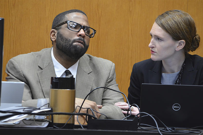 Defense attorney Katherine Poor comforts defendent Willie Cory Godbolt while Godbolt's 12-year-old daughter, My'Khyiah Godbolt, testifies on Monday, Feb. 17, 2020, on the third day of the capital murder trial of Godbolt at the Pike County Courthouse in Magnolia, Miss. Godbolt, 37, is on trial, for the May 2017 shooting deaths of eight people in Brookhaven. (Donna Campbell/The Daily Leader via AP, Pool)