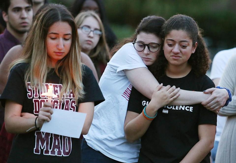 Students grieve during a candlelight vigil at Memory Mall on the UCF campus in Orlando, Fla., in commemoration of the one-year anniversary of the mass shooting at Marjory Stoneman Douglas High School, on Thursday, Feb. 14, 2019. (Stephen M. Dowell/Orlando Sentinel/TNS via Getty Images)