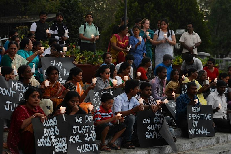 Activists from various women's rights organisation hold placards as they stage a silent demonstration against sexual assault and rapes on women, in Bangalore on April 22, 2015