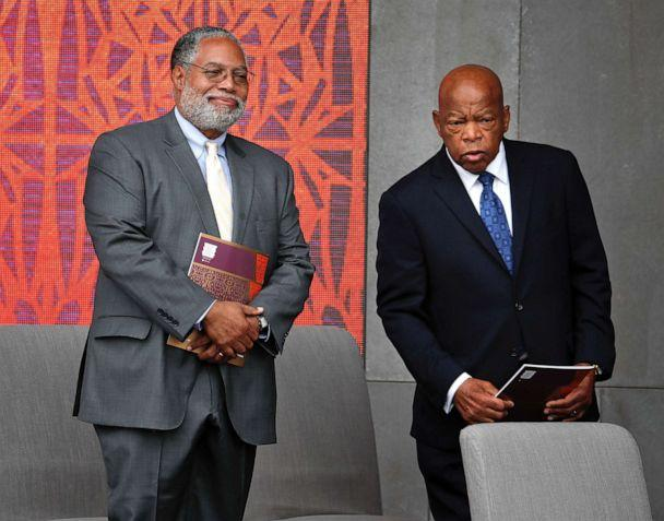 PHOTO: Lonnie Bunch, left, director of the Smithsonian Museum of African American History and Culture, left, and Rep. John Lewis, D-Ga. take their seats for the dedication ceremony of the Smithsonian Museum of African American History and Culture. (Pablo Martinez Monsivais/AP)