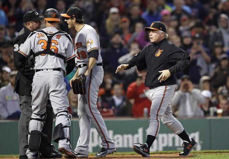 Orioles manager Buck Showalter rushes to home plate after starting pitcher Kevin Gausman was ejected for hitting Xander Bogaerts with a pitch. (AP)