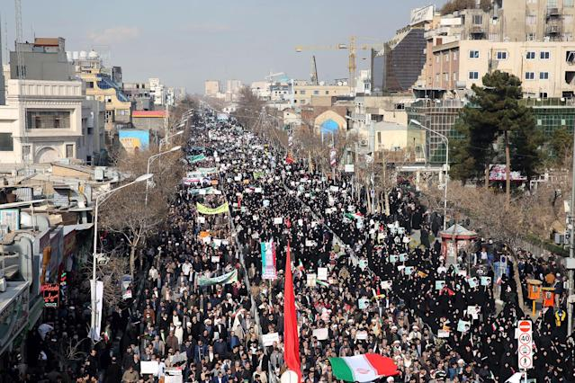 <p>Iranian pro-government supporters march during a rally in support of the regime after authorities declared the end of deadly unrest, in the city of Mashhad on Jan. 4, 2018. (Photo: Nima Najafzadeh/AFP/Getty Images) </p>