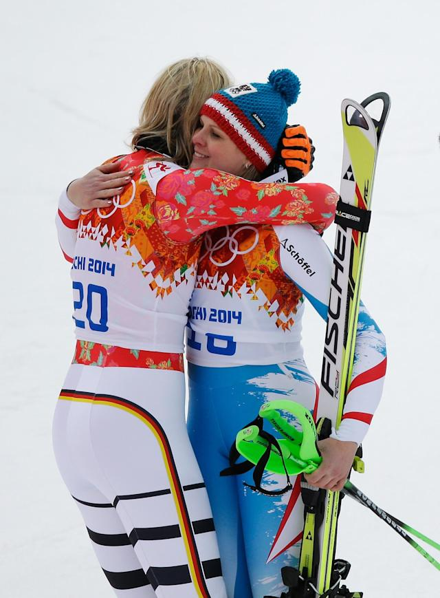 SOCHI, RUSSIA - FEBRUARY 10: (L-R) Gold medalist Maria Hoefl-Riesch of Germany embraces silver medalist Nicole Hosp of Austria during the Alpine Skiing Women's Super Combined Slalom on day 3 of the Sochi 2014 Winter Olympics at Rosa Khutor Alpine Center on February 10, 2014 in Sochi, Russia. (Photo by Ezra Shaw/Getty Images)