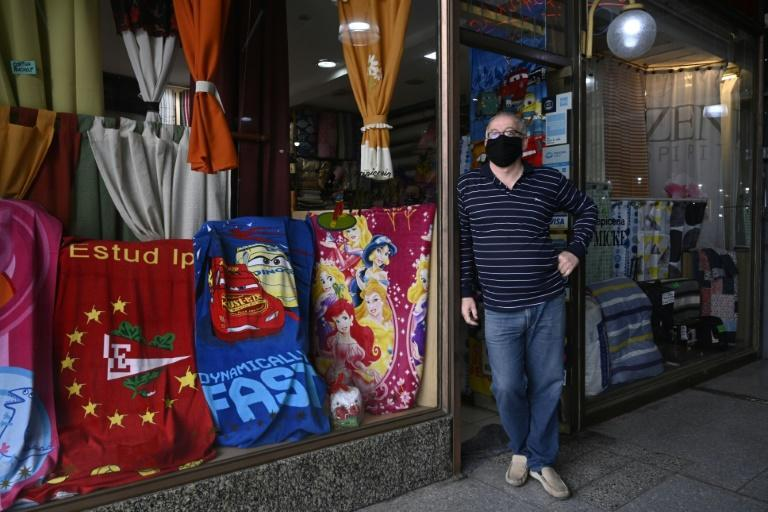 A salesman waits for customers at his store after lockdown measures to fight the coronavirus pandemic were relaxed in Buenos Aires